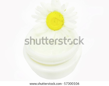 floral cosmetic creme for face with daisy medical essence - stock photo
