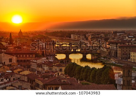 Florence, Arno River and Ponte Vecchio at sunset, Italy - stock photo