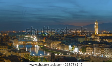 Florence city during sunset. Panoramic view to the river Arno, with Ponte Vecchio and  Palazzo Vecchio , Florence, Italy  - stock photo