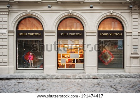 FLORENCE, ITALY - APRIL 16, 2012: Louis Vuitton flagship store in the Piazza degli Strozzi, luxury shopping street in Florence on April 16, 2012. The Louis Vuitton label was founded by Vuitton in 1854 - stock photo
