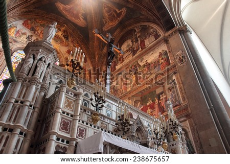 FLORENCE, ITALY - DECEMBER 7, 2014: Main altar in Santa Maria Novella church, gothic Italian masterpiece - stock photo