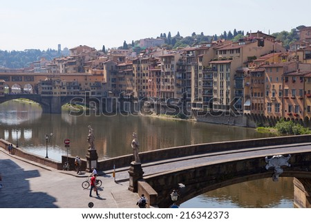 FLORENCE, ITALY - JUNE 11: Landscape of Anro riverbank in Florence, Italy on June 11, 2014. It is the most important river of central Italy after the Tiber and divides Florence into two parts. - stock photo
