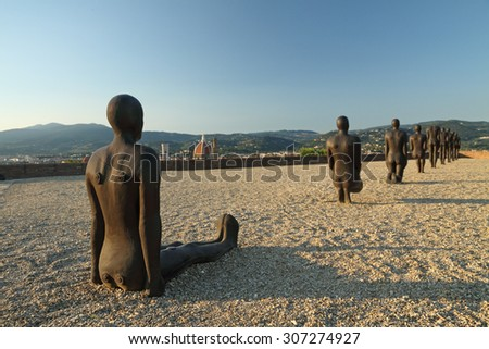 FLORENCE, ITALY - JUNE 20 :The installation  entitled Critical Mass by british artist  Antony Gormley located in Forte di Belvedere during the exhibition Human in Florence, Italy,  2015.    - stock photo