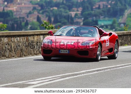 """FLORENCE, ITALY - MAY 19: Ferrari along Via Bolognese during the 1000 miles on May 19, 2013 in Florence, Italy . """"Mille Miglia"""" is a car race attempted by many celebrities - stock photo"""
