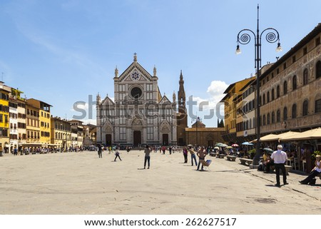FLORENCE, ITALY - MAY 20, 2014: The Basilica di Santa Croce (Basilica of the Holy Cross), built in the 15th century. This is one of the main attractions of the city. - stock photo