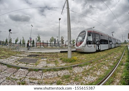 FLORENCE, ITALY - OCT 11: Tram transports tourists to city center, October 11, 2012 in Florence. Tram is a very useful way to enter the city avoiding traffic. - stock photo