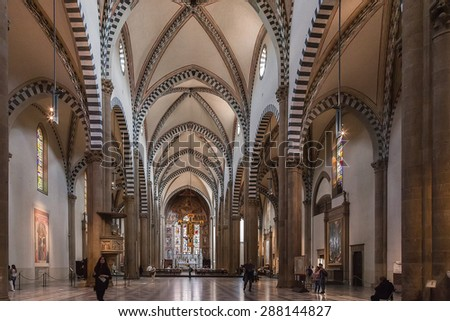 FLORENCE, ITALY - OCTOBER 08, 2013: The interior of Santa Maria Novella church. The church is famous for its frescoes by masters of Gothic and early Renaissance. - stock photo