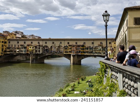 Florence, Italy - September 2014: Ponte Vecchio over the Arno river. September 2014 in Florence, Italy. - stock photo