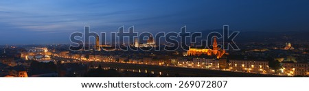 Florence panoramic format skyline shot at dusk. The city profile with the most important landmarks, ranging from Ponte Vecchio to the Great Synagogue are visible. Shot at twilight. - stock photo