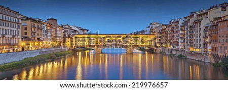 Florence. Panoramic image of historical center of Florence with Ponte Vecchio during twilight blue hour.  - stock photo