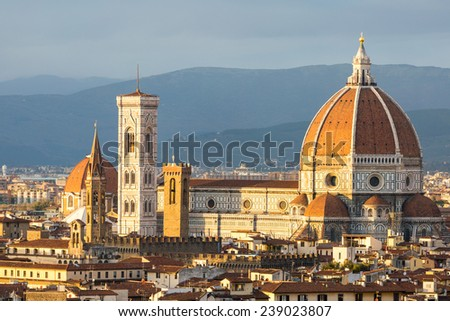 Florence, panoramic view of the cityscape from Piazzale Michelangelo at sunset, warm colors, romantic scene - stock photo