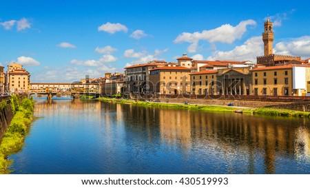 Florence, Ponte Vecchio bridge over river Arno and Palazzo Vecchio (Tuscany, Italy) - stock photo