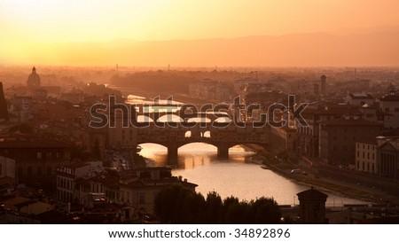 Florence skyline at sunset, Italy. Ponte Vecchio sull'Arno. - stock photo
