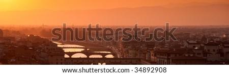 Florence skyline at sunset, Italy. Ponte Vecchio sull'Arno. Panorama. - stock photo
