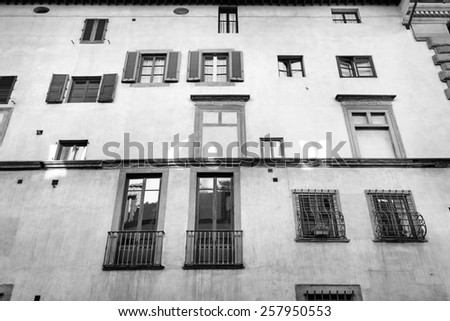 Florentine building facade with different windows - stock photo