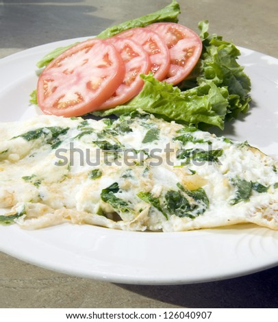 Florentine spinach egg white omelet feta cheese  tomato and lettuce - stock photo