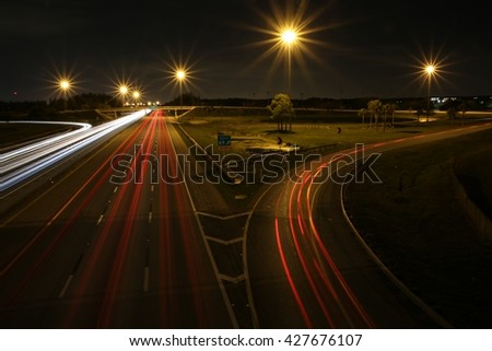 Florida Turnpike South at Pompano Beach Tail Lights and Off Ramp Night - stock photo