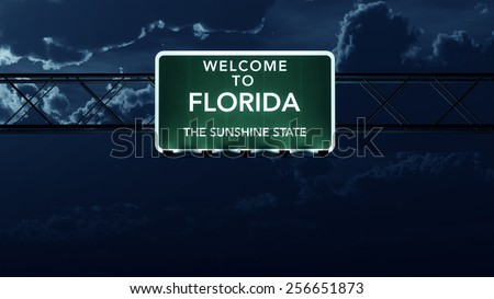 Florida USA State Welcome to Interstate Highway Road Sign at Night - stock photo