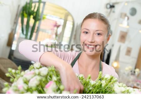 Florist arranging some flowers - stock photo