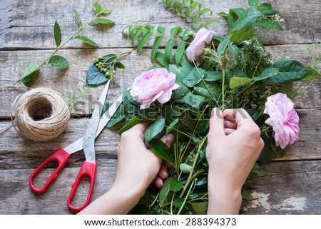 Florist at work. Woman making floral decorations - stock photo