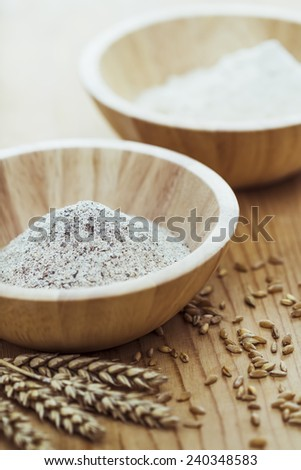 Flour and wheat on the table - stock photo