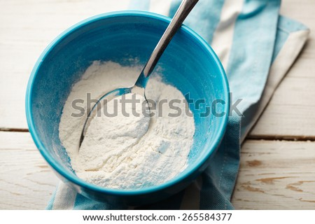 Flour in a bowl - stock photo
