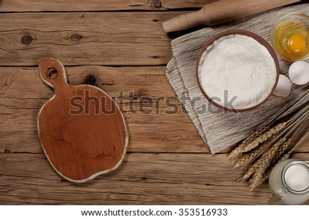 Flour in a bowl with ingredients for preparing baked products. Top view with a place for object - stock photo