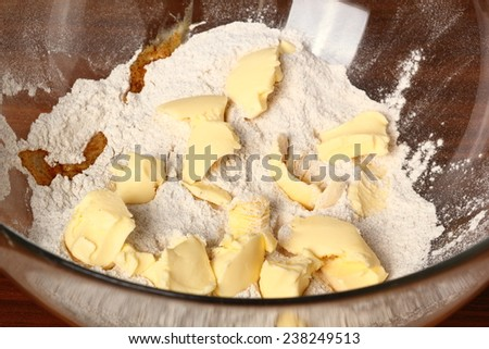 Flour mixture and butter. Making Christmas Gingerbread Cookies - stock photo