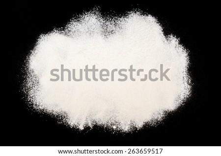 Flour on a black background - stock photo