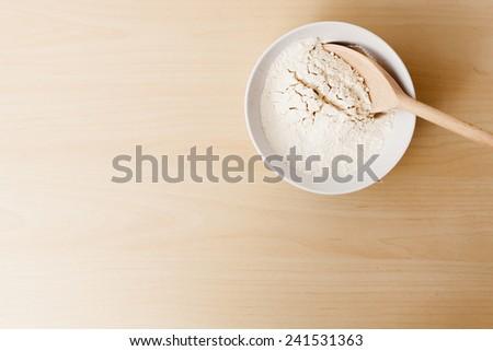 flour on a white bowl - stock photo
