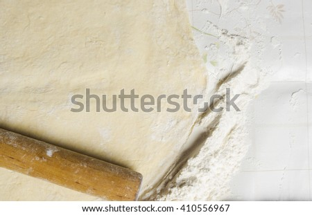 floured the dough on a wooden Board - stock photo