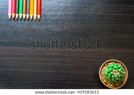 flower,and colorful pencils. View from above with copy space - stock photo