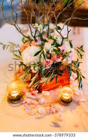 Flower arrangement at a wedding banquet - stock photo