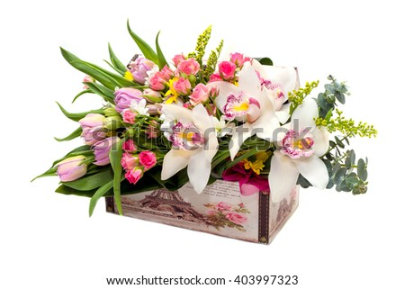 Flower Arrangement in a box for a girl of roses, tulips and orchids on a white background - stock photo