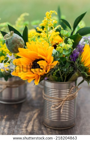 Flower arrangement in DIY vase. - stock photo