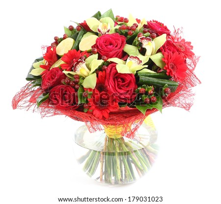 Flower arrangement in glass, transparent vase: red roses, orchids, red gerbera daisies. Isolated on white background. Floristic composition, design a bouquet, floral arrangement.  - stock photo