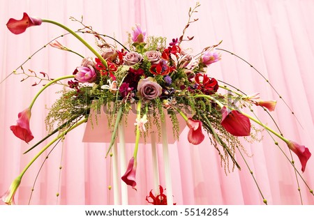 Flower arrangement in pink- red tones - stock photo