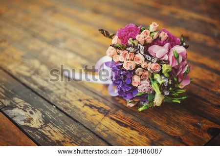 Flower Arrangement on a wood background - stock photo