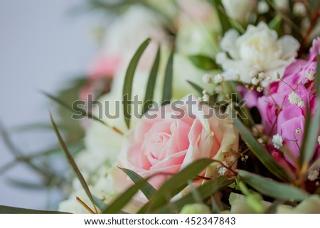 Flower arrangement on the table. Flowers and white tablecloth, wedding, roses, peonies - stock photo