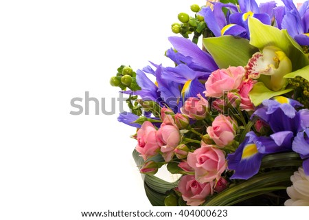 Flower arrangement with blue irises , white gerbera , green orchids and pink roses on a white background - stock photo