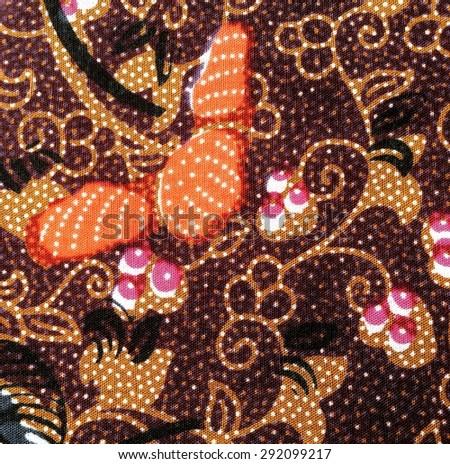 Flower Batik Sarong tile in smooth dark tone texture. - stock photo