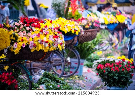 Flower bicycle at small market for florist vendor in Hanoi, Vietnam - stock photo