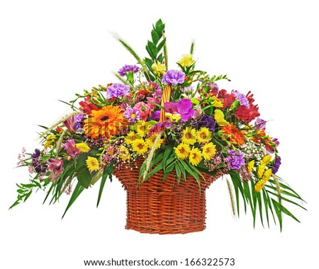 Flower bouquet arrangement centerpiece in wicker basket isolated on white background. Closeup. - stock photo