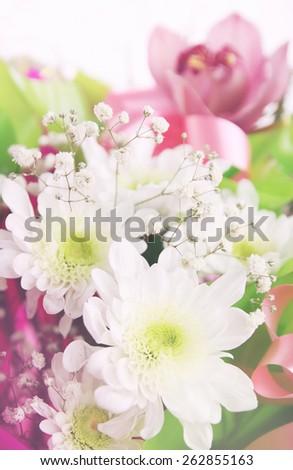 Flower composition of chrysanthemums, Phalaenopsis  and gypsophila - stock photo