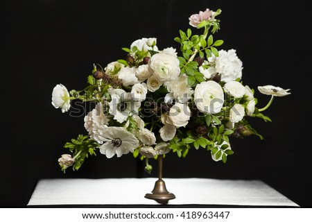 Flower composition on a black background. Wedding decor. Festive decor. Bouquet from spring flowers. Wedding bouquet. - stock photo