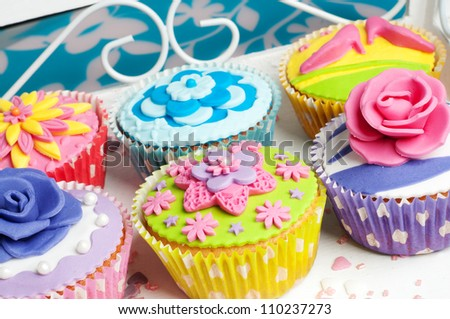 Flower decorated cupcakes for birthday or wedding celebration - stock photo