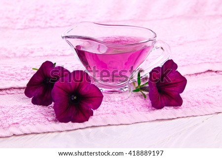 Flower essence on the towel - stock photo