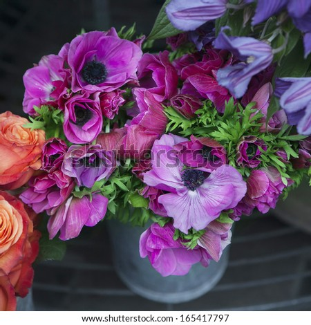 Flower for sale. purple anemone in zink bucket - stock photo