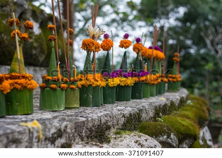 Flower for worship,People prepare to offer at Buddhist stupa at the Temple in Laos, Asia - stock photo