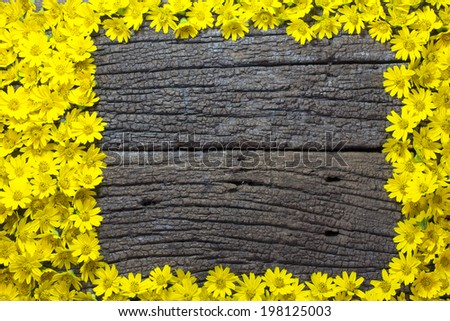 Flower frame on Wooden Background, with the space for the text - stock photo
